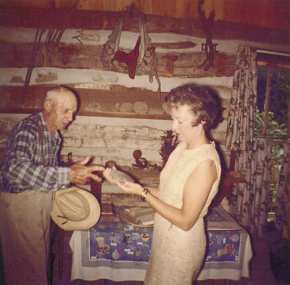 Henry Rogler with Mrs. James Folsom examining artifacts in the log cabin