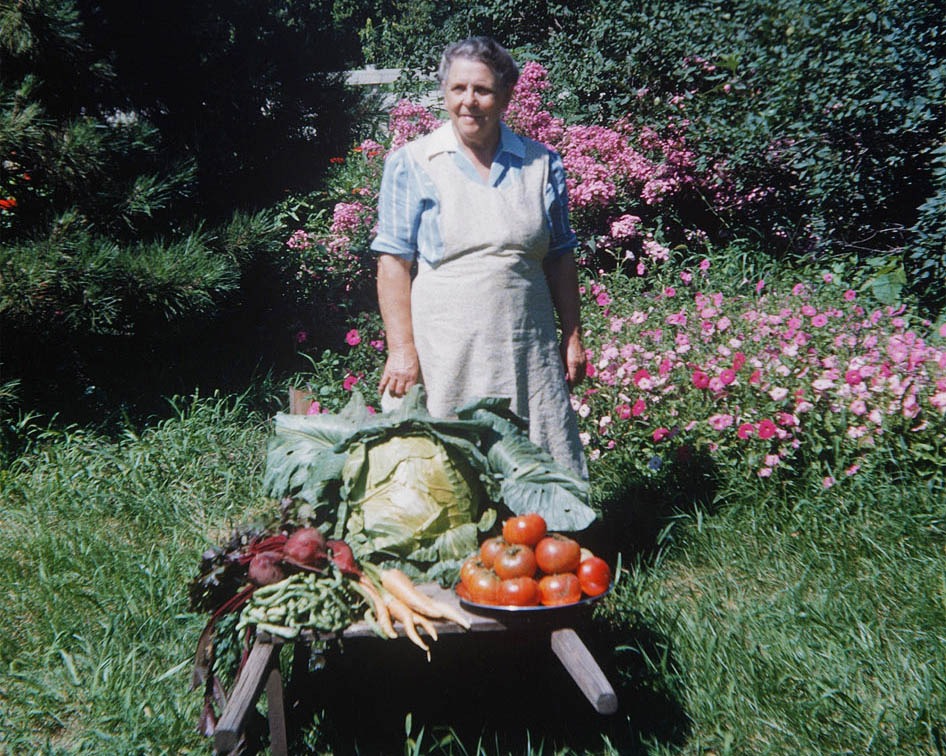 Maud Rogler with a wheelbarrow full of vegetable produce